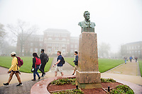 Drill Field foggy day - students walking between classes next to Stephen D. Lee statue.<br />  (photo by Megan Bean / &copy; Mississippi State University)