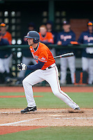 John La Prise (2) of the Virginia Cavaliers follows through on his swing against the Seton Hall Pirates at The Ripken Experience on February 28, 2015 in Myrtle Beach, South Carolina.  The Cavaliers defeated the Pirates 4-1.  (Brian Westerholt/Four Seam Images)