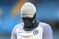 Michy Batshuayi of Chelsea warms up with a face mask on ahead of the Premier League match between Chelsea and Newcastle United at Stamford Bridge, London, England on 2 December 2017. Photo by David Horn.