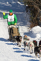 Musher Kelly Maixner on Long Lake at the Re-Start of the 2011 Iditarod Sled Dog Race in Willow, Alaska.