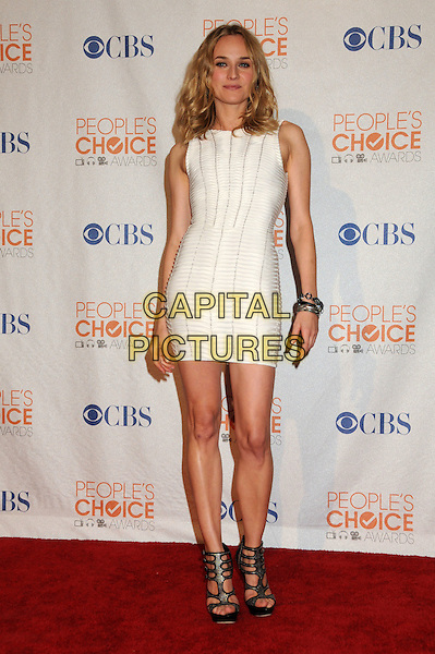 DIANE KRUGER .Pressroom at the 36th Annual People's Choice Awards held at the Nokia Theatre LA Live, Los Angeles, California, USA..January 6th, 2009.press room full length white dress black sandals heels sleeveless platform cut out silver studded studs bracelets mini .CAP/ADM/BP.©Byron Purvis/AdMedia/Capital Pictures.