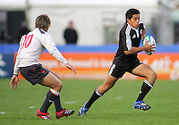 New Zealand full back Trent Reneta bursts through a gap in the Welsh defence during the Division A semi-final at Ravenhill. Result New Zealand 36 Wales 12.