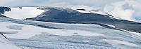 Panoramic of mountains of Jotunheimen National park and Styggebreen (Stygge glacier) in summer conditions with below average snow level, Norway