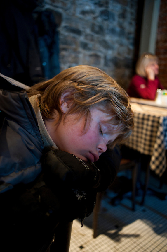 Felix asleep at a restaurant. Winter Carnival in Quebec City, Canada