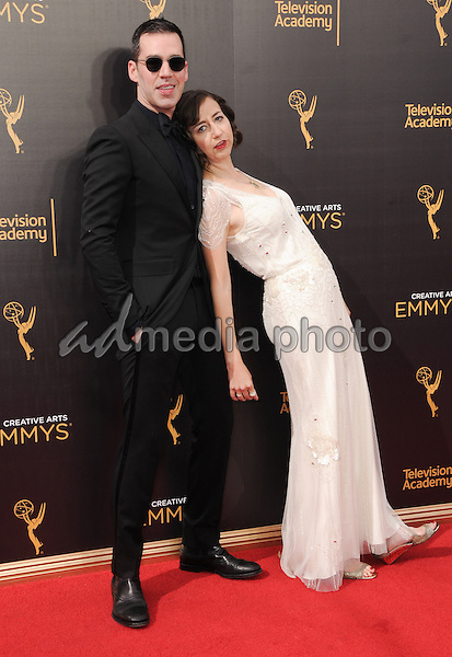 11 September 2016 - Los Angeles, California. Kristen Schaal, John Roberts. 2016 Creative Arts Emmy Awards - Day 2 held at Microsoft Theater. Photo Credit: Birdie Thompson/AdMedia