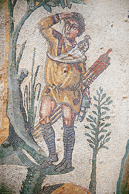 Hunter from the Room of The Small Hunt, no 25 - Roman mosaics at the Villa Romana del Casale which containis the richest, largest and most complex collection of Roman mosaics in the world, circa the first quarter of the 4th century AD. Sicily, Italy. A UNESCO World Heritage Site.