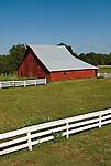 Red barn, white rail fence in rural Nebraska