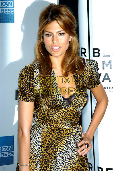 "EVA MENDES.6th Annual Tribeca Film Festival - Cadilac: ""Live!"" after party at Underbar, New York City, New York, USA,.28 April 2007..half length leopard print wrap maxi dress hand on hip black bra cleavage low cut.CAP/ADM/BL.©Bill Lyons/AdMedia/Capital Pictures. *** Local Caption ***"