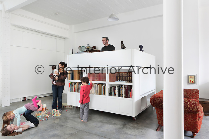 The Wingate family gathered around Richard's office in a box in the open plan living area