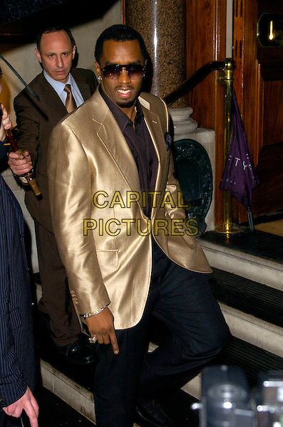 P DIDDY.The P Diddy celebrity party, 50 James Street restaurant, London, England..July 2nd, 2007.half 3/4 length black trousers gold suit jacket hand in pocket sunglasses shades .CAP/CAN.©Can Nguyen/Capital Pictures