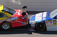 Apr 24, 2009; Talladega, AL, USA; NASCAR Sprint Cup Series driver Dale Earnhardt Jr bump drafts Marcos Ambrose during practice for the Aarons 499 at Talladega Superspeedway. Mandatory Credit: Mark J. Rebilas-