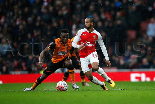 20.02.2016. The Emirates, London, England. Emirates FA Cup 5th Round. Arsenal versus Hull City. Theo Walcott of Arsenal tries to escape the attention of Moses Odubajo of Hull.  The game finished in a tight 0-0 draw
