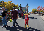 The Flash marches with his family in the parade during Pumpkin Palooza in Sparks, Nevada on Sunday, Oct. 22, 2017.