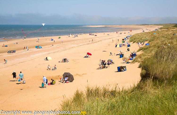 People on a wide sandy beach at Hunstanton, north Norfolk coast, England