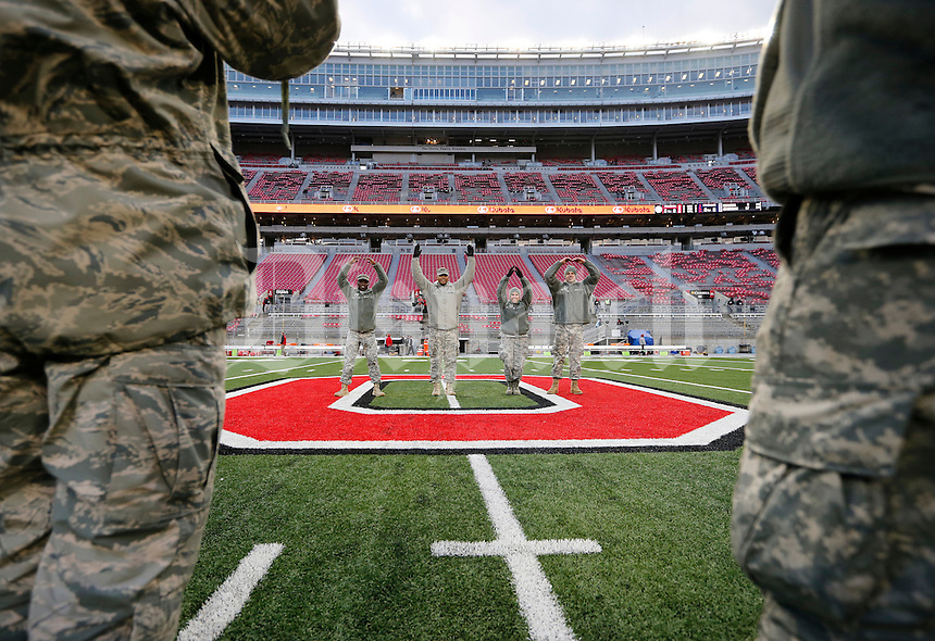 U.S. Army National Guard members, from left, Zavaughn Moss, David Wallace, Jordyn Discenzo and Lucas Willis spell out O-H-I-O at mid-field prior to Military Appreciation Night prior to the NCAA football game at Ohio Stadium on Nov. 1, 2014. (Adam Cairns / The Columbus Dispatch)