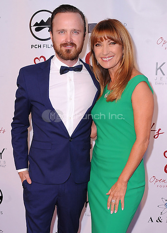 MALIBU, CA - MAY 10:  Aaron Paul and Jane Seymour at the 4th Annual Open Hearts Gala at a private residence on May 10, 2014 in Malibu, California. Credit: PGSK/MediaPunch