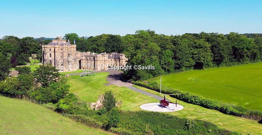 BNPS.co.uk (01202 558833)<br /> Pic: Savills/BNPS<br /> <br /> Helicopter pad for the short commute to Edinburgh.<br /> <br /> Every man's home may be his castle, but you'll need £8 million to buy this spectacular Scottish version that's the real thing.<br /> <br /> The impressive castle built on the site of one of Mary Queen of Scots' favourite retreats has just been put on the market.<br /> <br /> Seton Castle stands proudly in the East Lothian countryside in the same spot that used to be home to the royal Seton Palace.<br /> <br /> The palace, which was demolished in 1789, was regularly stayed in by the Scottish queen as well as her son James I.<br /> <br /> Its stone was used to build the current castle which was designed by acclaimed architect Robert Adam and completed in 1791.