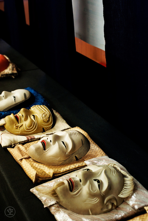 Teaching masks (Kojima Oun) on display.
