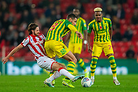 4th November 2019; Bet365 Stadium, Stoke, Staffordshire, England; English Championship Football, Stoke City versus West Bromwich Albion; Joe Allen of Stoke City tackles Jake Livermore of West Bromwich Albion - Strictly Editorial Use Only. No use with unauthorized audio, video, data, fixture lists, club/league logos or 'live' services. Online in-match use limited to 120 images, no video emulation. No use in betting, games or single club/league/player publications