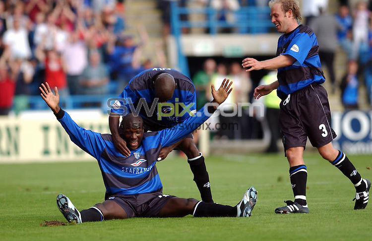 Pix: Daniel Hambury/SWpix.com...Nationwide Division One... Gillingham v Millwall... 6/9/03..COPYRIGHT PICTURE>>SIMON WILKINSON>>0870 0920 092..GILLINGHAM'S NYRON NOSWORTHY CELEBRATES HIS WINNER
