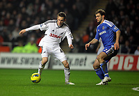 Pictured L-R: Gylfi Sigurdsson of Swansea against Branislav Ivanovic of Chelsea. Tuesday, 31 January 2012<br />