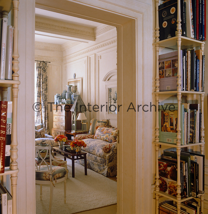 A pair of tall narrow bookcases flanks the doorway to the living room