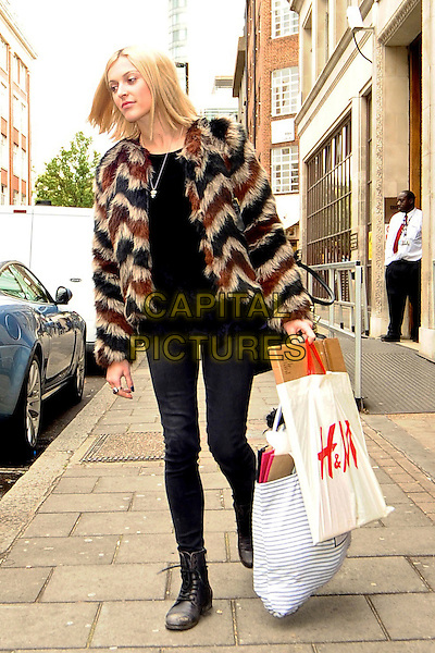 Fearne Cotton spotted in London, England..October 10th, 2011.full length black jeans denim top brown zip zag fur furry jacket h&m shopping bag plastic carrier .CAP/DYL.©Dylan/Capital Pictures.