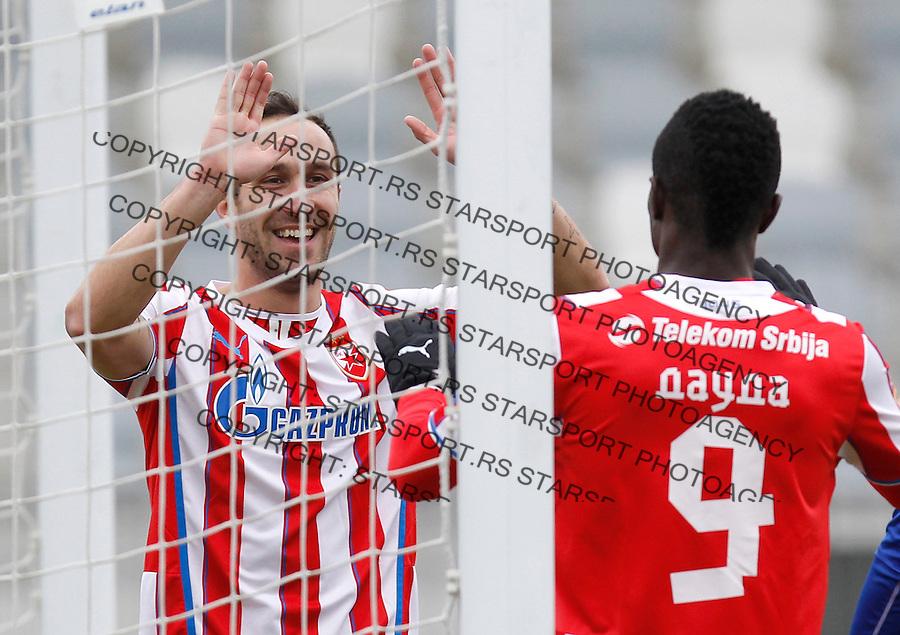 Fudbal season 2013-2014<br /> FK Crvena Zvezda pripreme Portoroz-Koper<br /> Crvena Zvezda v Triglav<br /> Dragan Mrdja (L) and Abiola Dauda celebrate<br /> Koper, 01.27.2014.<br /> foto: Srdjan Stevanovic/Starsportphoto &copy;