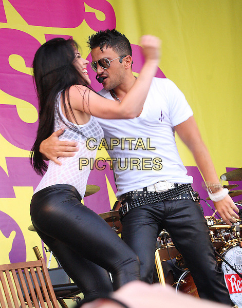 PETER ANDRE.Midlands Music Festival at Tamworth Castle, Staffordshire, England, UK..July 18th 2010.stage concert live gig performance music half length white t-shirt singing belts leather black trousers dancer arm around waist profile dancing sunglasses shades .CAP/JIL.©Jill Mayhew/Capital Pictures