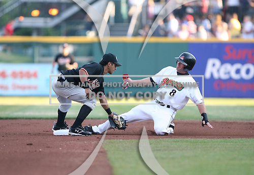 Eider Torres of the Norfolk Tides tags Joe Inglett of the Buffalo Bisons:  June 26th, 2007 at Dunn Tire Park in Buffalo, NY.  Photo copyright Mike Janes Photography 2007.