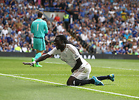 Bafetimbi Gomis of Swansea celebrates scoring his sides second goal   during the Barclays Premier League match between  Chelsea and Swansea  played at Stamford Bridge, London