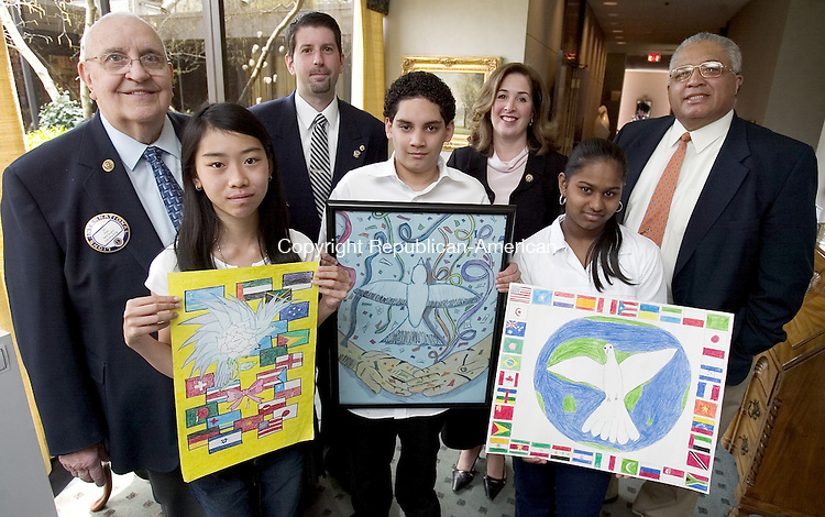WATERBURY, CT. 26 April 2007-042607SV02--&nbsp;From left, Michael Granatuk, Chairman of the Lions Club Peace Poster Contest, Nicole Nguyen, 13, of Wallace Middle School, Richard Zappone, Waterbury Lions Club President, Edgar Vargas, 13, of Northend Middle School, Elizabeth McGrath, Supervisor of Visual Arts for the Dept. of Education, Narsana Gobindraj, 12, of Westside Middle School and Dr. David Snead Superintendent of Schools attended the awards luncheon at the Waterbury Club in Waterbury Thursday. Nguyen, Vargas, and Gobindraj were the Lions Club peace poster contest winners. Vargas was also a district winner of the contest.<br /> Steven Valenti Republican-American