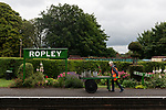 Pictured: Volunteer gardener Heather Wilson carries watering cans on a platform truck at Ropley Station ahead of the reopening of the Mid Hants Railway to the general public this Saturday, 11th July.<br /> <br /> © Jordan Pettitt/Solent News & Photo Agency<br /> UK +44 (0) 2380 458800