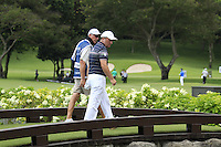 Damien McGrane (IRL) and caddy John Hort cross the footbridge to the 17th tee during Friday's Round 2 of the 2011 Barclays Singapore Open, Singapore, 11th November 2011 (Photo Eoin Clarke/www.golffile.ie)