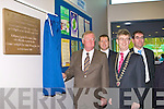 John O'Donoghue unveils the plague at the official opening of the Killarney Sports and Leisure Centre on Friday