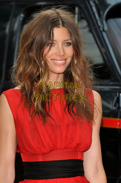JESSICA BIEL.'The A-Team' UK film premiere at Empire cinema, Leicester Square, London, England 27th July 2010.half length red sleeveless sheer black waistband wavy messy hair smiling .CAP/PL.©Phil Loftus/Capital Pictures.