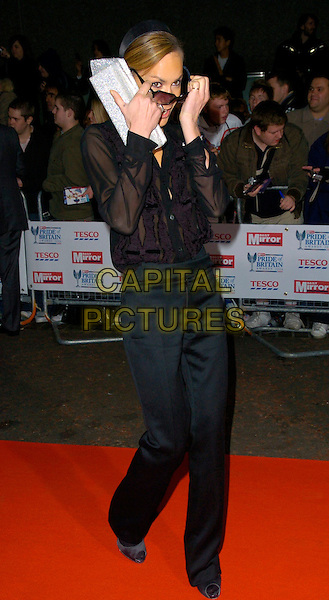 TARA PALMER TOMKINSON.The Daily Mirror's Pride Of Britain Awards, London Television Studios, London, UK..November 6th, 2006.Ref: CAN.full length black trousers top sheer sunglasses shades silver clutch purse.www.capitalpictures.com.sales@capitalpictures.com.©Can Nguyen/Capital Pictures