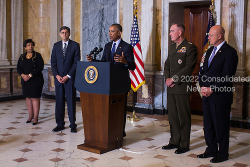 United States President Barack Obama (C) speaks on the Orlando shooting at the Treasury Department while Attorney General Loretta Lynch (L), Treasury Secretary Jack Lew (C-L), Chairman of the Joint Chiefs of Staff General Joseph Dunford (C-R) and Director of National Intelligence James Clapper (R) look on in Washington, DC, USA, 14 June 2016. Obama used the opportunity to directly attacked Donald Trump's proposal to ban Muslims from entering the United States<br /> Credit: Jim LoScalzo / Pool via CNP