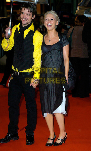 "ANDREW LEE POTTS & HANNAH SPEARITT.""Becoming Jane"" World Premiere, Odeon West End, .London, England, March 4th 2007..full length black and white skirt dress shoes holding hands raining umbrella.CAP/CAN.©Can Nguyen/Capital Pictures"