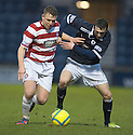 Accies Conner McGlinchey and Raith's David Smith challenge for the ball.
