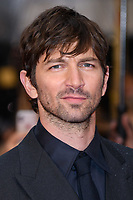 """Michiel Huisman<br /> arriving for the world premiere of """"The Guernsey Literary and Potato Peel Pie Society"""" at the Curzon Mayfair, London<br /> <br /> ©Ash Knotek  D3394  09/04/2018"""