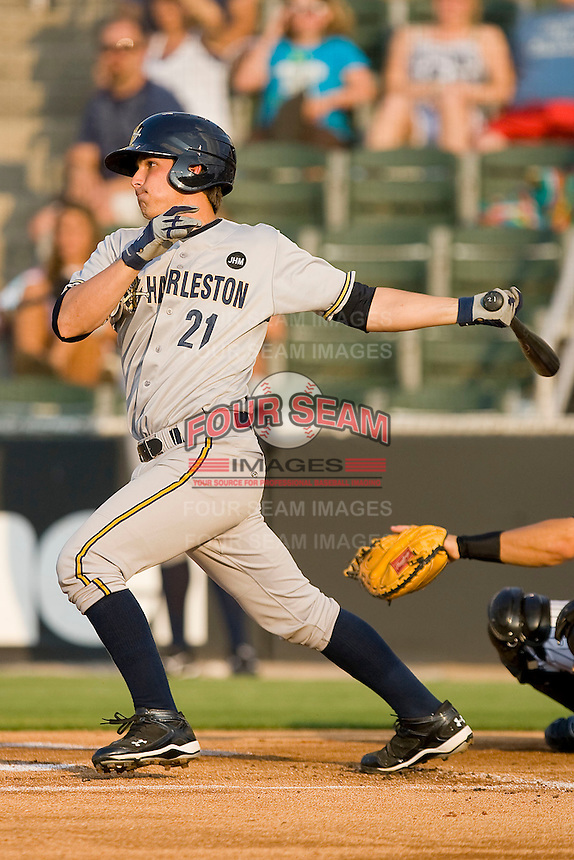 J.R. Murphy #21 of the Charleston RiverDogs follows through on his swing against the Kannapolis Intimidators at Fieldcrest Cannon Stadium May 29, 2010, in Kannapolis, North Carolina.  Photo by Brian Westerholt / Four Seam Images