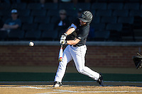 Nate Mondou (10) of the Wake Forest Demon Deacons follows through on his swing against the Florida State Seminoles at David F. Couch Ballpark on April 16, 2016 in Winston-Salem, North Carolina.  The Seminoles defeated the Demon Deacons 13-8.  (Brian Westerholt/Four Seam Images)