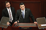 Governor Brian Sandoval delivers his State of the State address Monday, Jan. 24, 2011, at the Legislature in Carson City, Nev. An unidentified Legislative aide is at left..Photo by Cathleen Allison