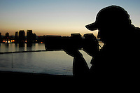 1060111-N-7981E-001 Pacific Ocean (January 11, 2006)- Photographer's Mate Airman Geoffrey Lewis documents surface contacts aboard the USS Abraham Lincoln (CVN-72). The Lincoln is currently underway off the coast of California for Board of Inspection and Survey. U.S. Navy photo by Photographer's Mate Airman Apprentice James R. Evans (RELEASED)