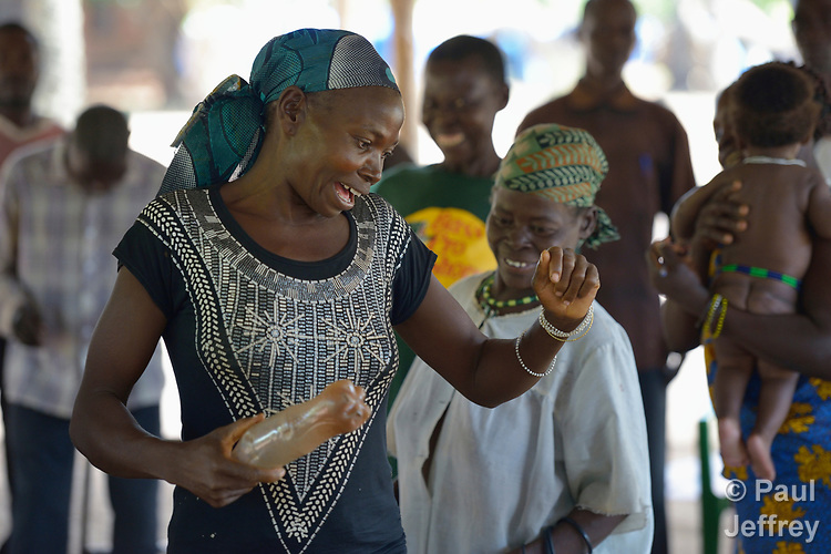 A woman dances with other participants in a church-sponsored trauma healing workshop in a camp for more than 5,000 displaced people in Riimenze, in South Sudan's Gbudwe State, what was formerly Western Equatoria. Families here were displaced at the beginning of 2017, as fighting between government soldiers and rebels escalated.<br />