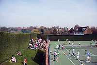 Parents and their children warm up for a coaching session with Dan Bloxham (right) as part of the Junior Tennis initiative at Wimbledon, The All England Lawn Tennis Club (AELTC), London..