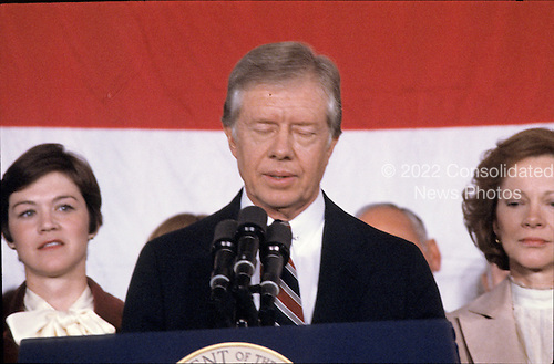 United States President Jimmy Carter makes remarks conceding the election to Republican Ronald Reagan at the Sheraton Washington Hotel in Washington, DC on November 4, 1980.  Firsy lady Rosalynn Carter looks on from right.<br /> Credit: Benjamin E. &quot;Gene&quot; Forte / CNP