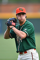 Starting pitcher Dustin Biggs (12) of the Greensboro Grasshoppers warms up before a game against the Greenville Drive on Tuesday, April 25, 2017, at Fluor Field at the West End in Greenville, South Carolina. Greenville won, 5-1. (Tom Priddy/Four Seam Images)