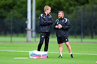 Graham Potter (right)  Manager of Swansea City and Billy Reid, assistant manager for Swansea in discussion during the Swansea City Training Session at The Fairwood Training Ground, Wales, UK. Tuesday 11th September 2018
